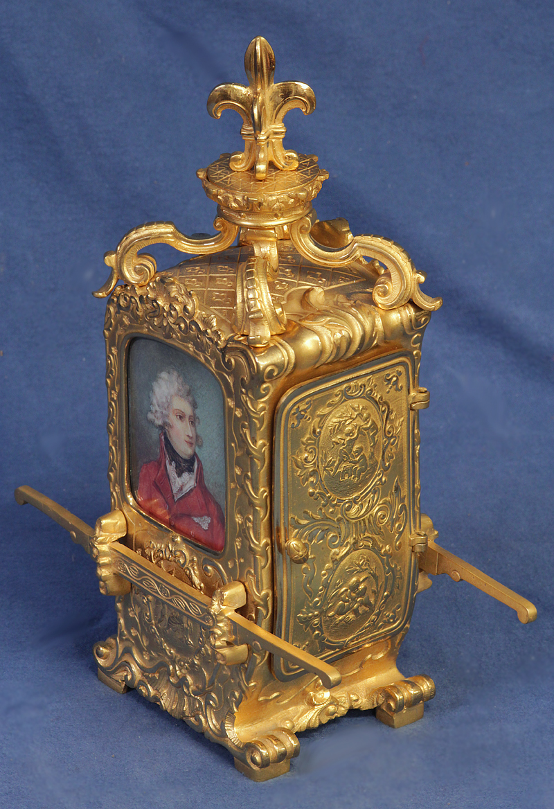 Sedan carriage clock with miniature portraits.